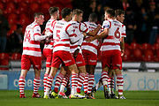 Doncaster Rovers celebrate after Doncaster Rovers midfielder Tommy Rowe (10) header is deflected for Portsmouth defender Christian Burgess (6) to score an own goal to make the score 2-0  during the EFL Sky Bet League 1 match between Doncaster Rovers and Portsmouth at the Keepmoat Stadium, Doncaster, England on 17 October 2017. Photo by Simon Davies.