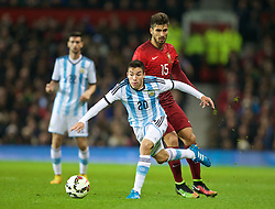 MANCHESTER, ENGLAND - Tuesday, November 18, 2014: Argentina's Nicolas Gaitan in action against Portugal's Andre Gomes during the International Friendly match at Old Trafford. (Pic by David Rawcliffe/Propaganda)