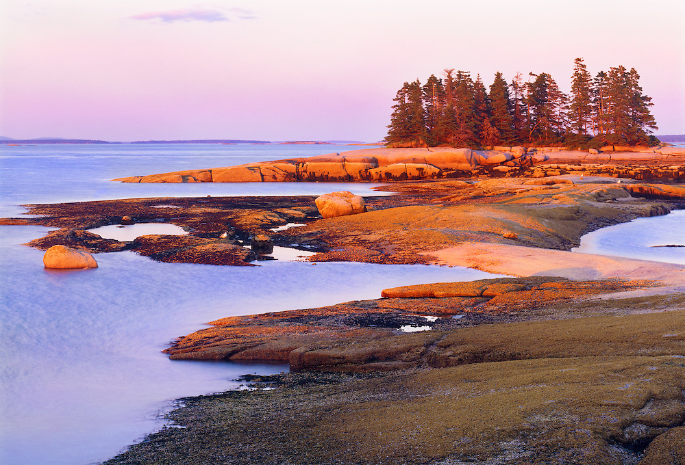 0903-1002 ~ Copyright: George H.H. Huey ~ Sunset on the ledges of Devil Island.  One of thirty small silands that comprise Merchants Row, between Deer Isle and Isle au Haut.  Jericho Bay, Hancock County, Maine.