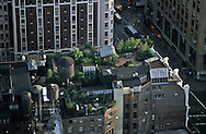 New York. elevated view. Manhattan , terrace in Chelsea area , water tank, rooftops  New york - United states aerial view / Sud de Manhattan, terrasse, quartier de Chelsea.  reservoir d eau; toits  New york - Etats unis  vue aerienne /