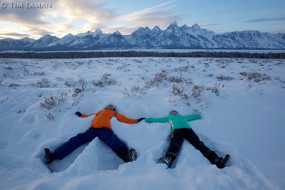 Russell and Jessica Laman (ages 12 and 9) make snow angels below the Tetons.<br />