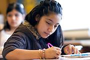 Latina student writing in class