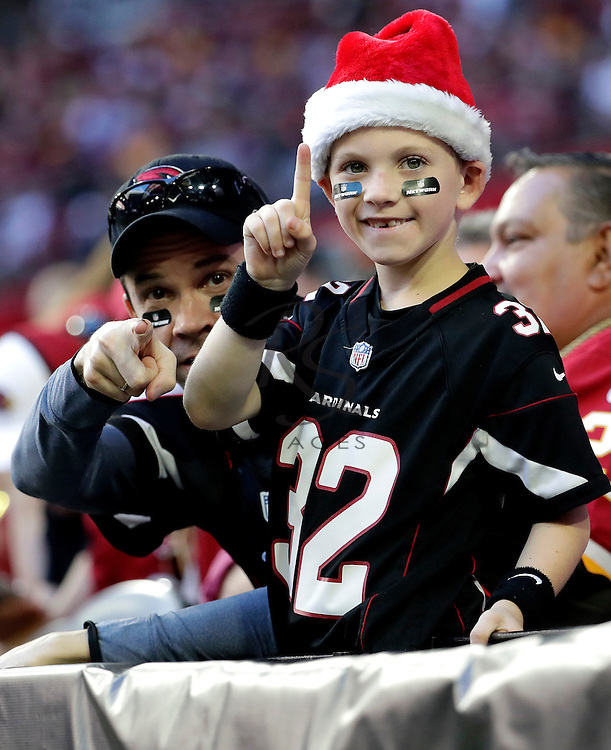 An Arizona Cardinals fan signals number one during the first half of an NFL football game against the Washington Redskins, Sunday, Dec. 4, 2016, in Glendale, Ariz. (AP Photo/Rick Scuteri)