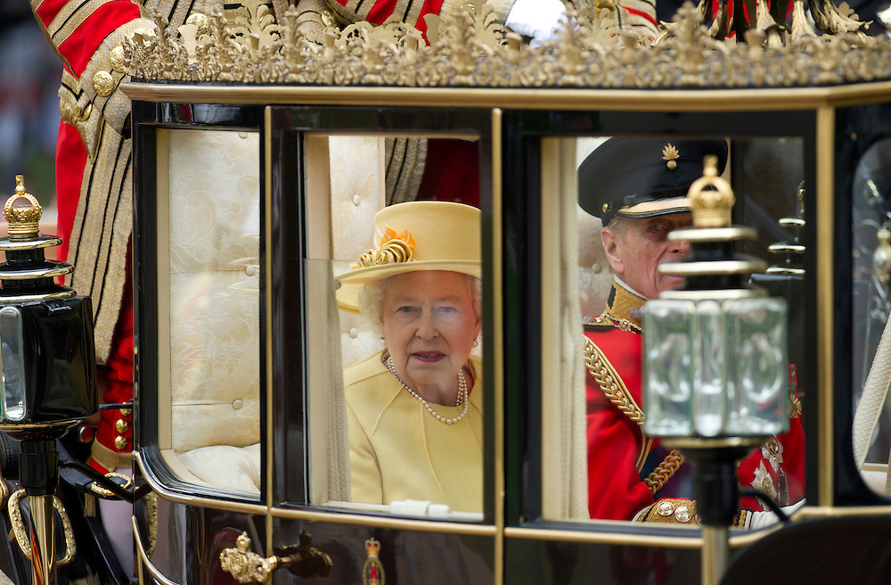 Britain's Queen Elizabeth II and Prince Philip travel in a Semi State Landau carriage with a Sovereign's Escort of the Household Cavalry, along the Processional Route to Buckingham Palace in London, on April 29, 2011. (AP Photo/Bogdan Maran)