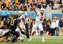 Oct 28, 2017; Morgantown, WV, USA; Oklahoma State Cowboys quarterback Mason Rudolph (2) passes the ball during the first quarter against the West Virginia Mountaineers at Milan Puskar Stadium. Mandatory Credit: Ben Queen-USA TODAY Sports