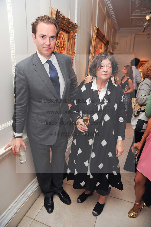 FAY MASCHLER and SIMON DAVIS at a party to celebrate the launch of Page One an online guide to London's 100 most rewarding restaurants held at the Halcyon Gallery, Bruton Street, London on 7th July 2010.