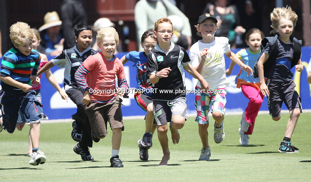 Kids run onto the field during a National Bank promotion on Day 1 of the 2nd test match.  New Zealand Black Caps v Pakistan, Test Match Cricket. Basin Reserve, Wellington, New Zealand. Saturday 15 January 2011. Photo: Andrew Cornaga/photosport.co.nz