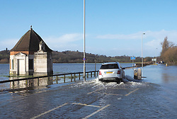 The flooded Windsor Road in  Egham, United Kingdom. Saturday, 8th February 2014. Picture by Max Nash / i-Images