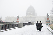Visitors walks towards the U.S. Capitol in the snow after the March for Life in Washington, DC on January 22, 2016. Activists from across the nation participated in the annual pro-life rally protesting abortion and the 1973 Roe v. Wade Supreme Court decision legalizing abortion.  Photo by Molly Riley/UPI