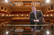 Reflected in the Steinway piano on stage at Mechanics Hall, executive director of Music Worcester, Adrien Finlay looks ahead to the new season.