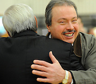 Former student Bill McCabe (right), of Hanover, New Jersey hugs his former coach Bob Ayton (track and cross country)  during a Salute to Hatboro-Horsham Coaching Legends Friday January 15, 2016 at Hatboro-Horsham High School in Hosham, Pennsylvania. (Photo by William Thomas Cain)