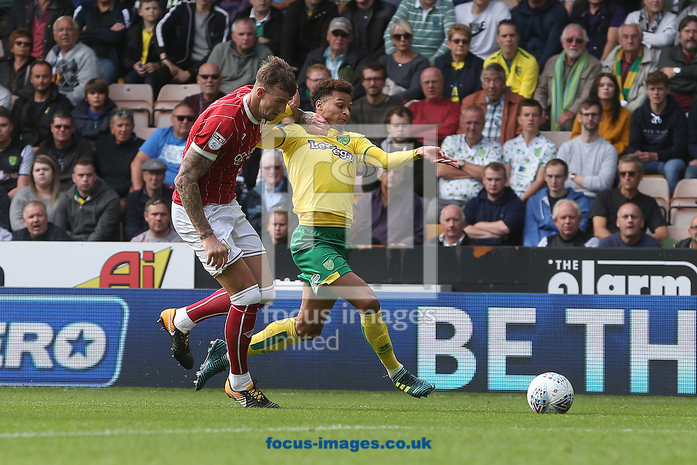 Josh Murphy of Norwich and Aden Flint of Bristol City in action during the Sky Bet Championship match at Carrow Road, Norwich<br /> Picture by Paul Chesterton/Focus Images Ltd +44 7904 640267<br /> 23/09/2017