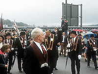 Rev Ian Paisley, leader, Democratic Unionist Party and Moderator of the Free Presbyterian Church, takes part in the annual parade of the Apprentice Boys of Derry as it crosses over the Craigavon Bridge. 12th August 1972. 197208120457a<br />
