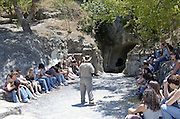 "Students and instructor at the entrance to Rabbi Yehuda Hanasi's catacomb at Beit Shearim Israel The Jewish town of Beit She'arim flourished during the 2-4 centuries CE (the Roman period). The people of Beit She'arim dug ornate catacombs, interconnected by tunnels, creating a huge underground necropolis - a city of the dead. The caves are full of stylized sarcophagi, decorated with Jewish and secular symbols. Beit She'arim was destroyed during the mutiny against Galos the emperor in the year 352 CE. The town of Beit She'arim became an important spiritual center when Rabbi Yehuda Hanasi (""Rabbi""), who was the spiritual authority of the time, made his home there. Rabbi was known as the sealer of the ""Mishna"". Rabbi also moved the ""Sanhedrin"" (the religious-judicial authority) to Beit She'arim. When he died in the year 220 CE, Rabbi was buried in one of the caves, a fact that made Beit Shearim an important burial place, for Jews of Israel and the Diaspora.  during excavations done in th"