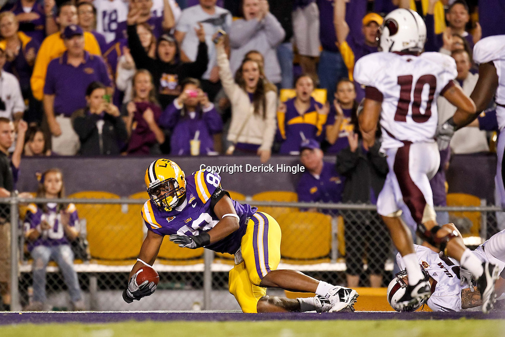 November 13, 2010; Baton Rouge, LA, USA; LSU Tigers defensive end Lavar Edwards (89) returns a fumble for a touchdown during the second half against the Louisiana Monroe Warhawks at Tiger Stadium. LSU defeated Louisiana-Monroe 51-0.  Mandatory Credit: Derick E. Hingle