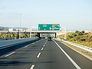 Greek Highway and road sign to Athens
