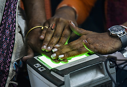 October 8, 2018 - Guwahati, India - Women scanning fingerprints as an Adhar registration process in an Adhar registration office in Guwahati, Assam, India on Monday, October 8, 2018. Aadhaar is an individual identification number issued by the Unique Identification Authority of India (UIDAI) on behalf of the Government of India to individuals for the purpose of establishing the unique identity of every single person. (Credit Image: © David Talukdar/NurPhoto/ZUMA Press)