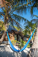 Exterior of a bungalow at Villa Pescadores hotel and beach club in Tulum, Mexico.