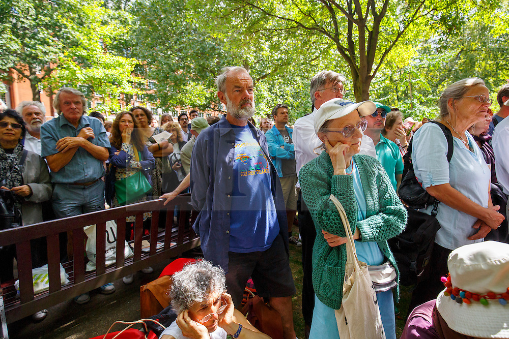 © Licensed to London News Pictures. 06/08/2015. London, UK. People listening Labour Party leader candidate Jeremy Corbyn at a Campaign for Nuclear Disarmament rally to mark the 70th Anniversary of the atomic bombings of Hiroshima and Nagasaki in Tavistock Square, London on Thursday, August 6, 2015. Photo credit: Tolga Akmen/LNP