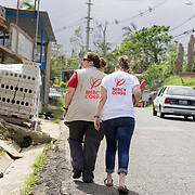 OCTOBER 18 - LARES, PUERTO RICO - <br /> Mercy Corps staffers Jill Morehead, left, and Alexa Swift, walk up a hill in Lares as part of their field research on Puerto Rico's supply needs following the destructive path of hurricane Maria.<br /> (Photo by Angel Valentin for NPR)