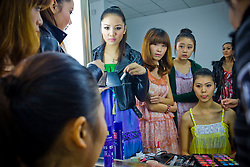 """Participants of """"Miss. International"""" beauty contest put on makeup before the show in Beijing, China, Nov. 7, 2009."""
