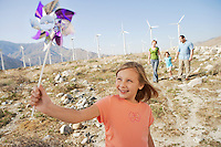 Smiling Girl with Pinwheel on a Wind Farm