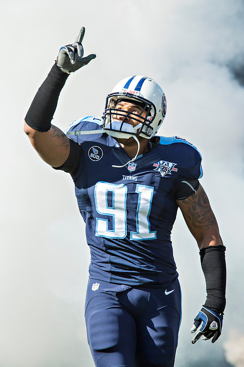 NASHVILLE, TN - NOVEMBER 10:  Derrick Morgan #91 of the Tennessee Titans runs onto the field before a game against the Jacksonville Jaguars at LP Field on November 10, 2013 in Nashville, Tennessee.  The Jaguars defeated the Titans 29-27.  (Photo by Wesley Hitt/Getty Images) *** Local Caption *** Derrick Morgan