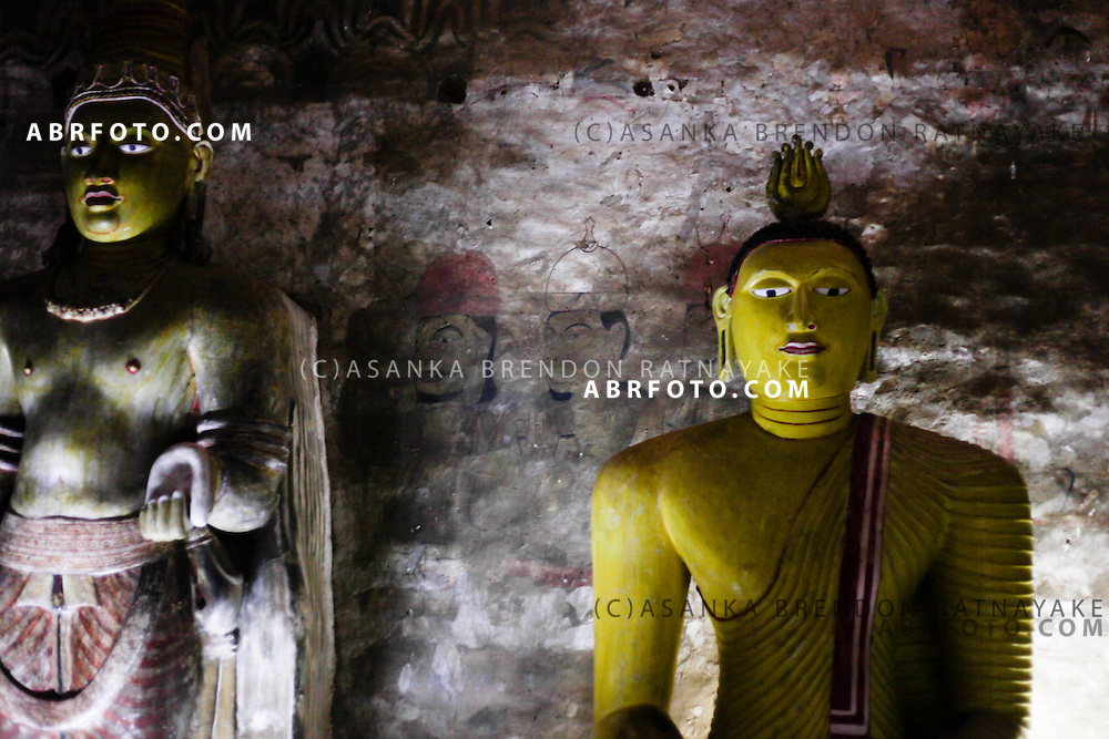 One of the 153 Buddha statues inside the Rock Temple in Dambulla