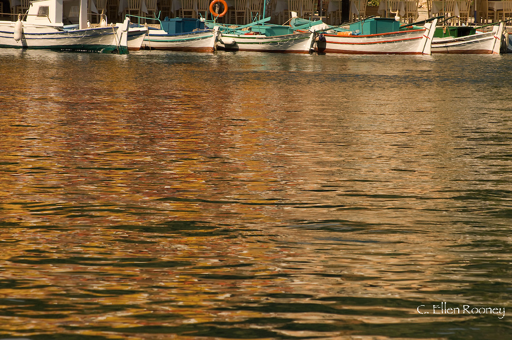 Fishing boats and reflections in the water in Kioni, Ithaca, The Ionian Islands, Greece