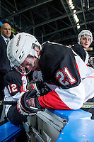 KELOWNA, CANADA - OCTOBER 23: Jared Bethune #21 of Prince George Cougars stands at the bench against the Kelowna Rockets on October 23, 2015 at Prospera Place in Kelowna, British Columbia, Canada.  (Photo by Marissa Baecker/Shoot the Breeze)  *** Local Caption *** Jared Bethune;