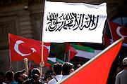 Mainz | 18 July 2014<br /> <br /> Am Samstag (18.07.2014) nahmen etwa 1000 M&auml;nner, Frauen und Kinder in der Innenstadt von Mainz anl&auml;sslich der milit&auml;rischen Auseinandersetzung zwischen Israel und der Hamas in Gaza an einer Solidarit&auml;tsdemonstration f&uuml;r Gaza, ein freies Pal&auml;stina und gegen Israel teil. Bei der Demo wurden Fahnen der Hamas und der Hisbollah mitgef&uuml;hrt, neben den &uuml;blichen Parolen gegen Israel wurde in Sprechch&ouml;hren auch vereinzelt zur Vernichtung von J&uuml;dinnen und Juden aufgerufen.<br /> Hier: Auch t&uuml;rkische Fahnen wurden neben vielen anderen mitgef&uuml;hrt.<br /> <br /> <br /> &copy;peter-juelich.com<br /> <br /> [No Model Release | No Property Release]