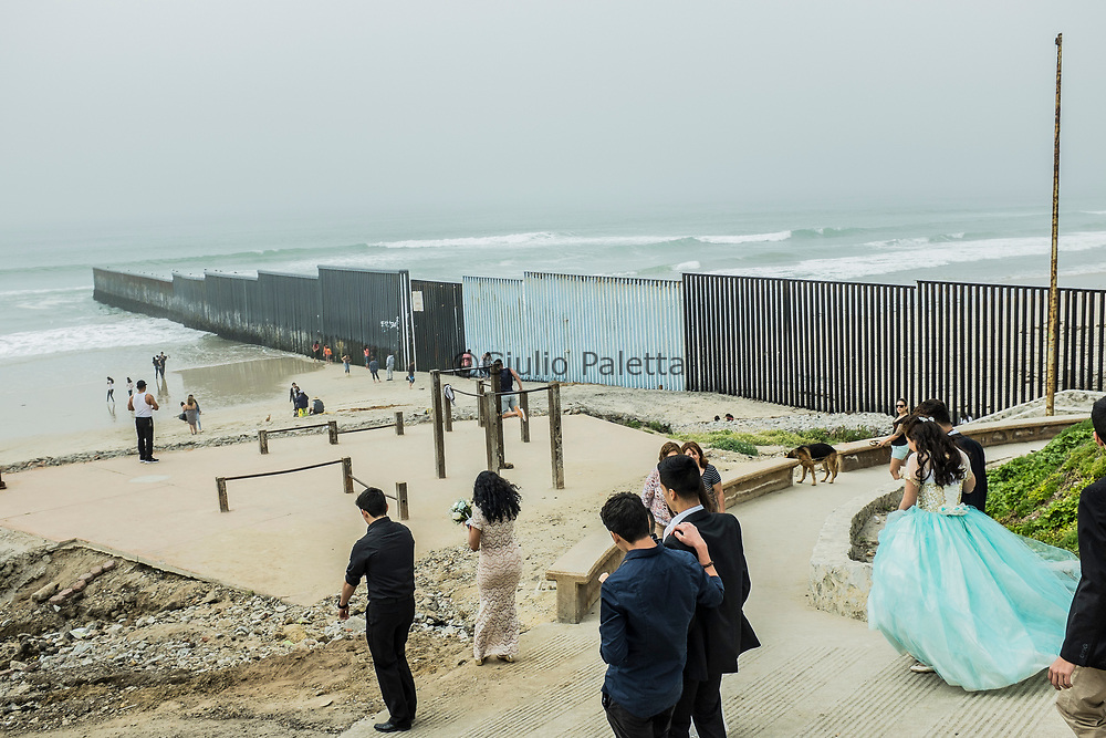 Playas de Tijuana. Life and everyday scenes at the beach of Tijuana. The beginning of the infamous wall between Mexico and United States of America, that starts in the Pacific Ocean and goes all the way for more than 1,000 km until Ciudad Juarez / El Paso border, in Texas