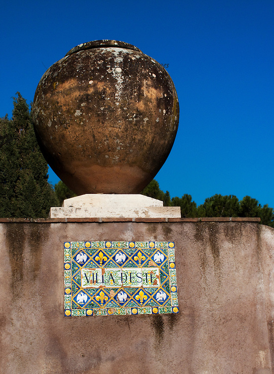Tivoli, Villa d'Este, garden and waterworks.  Entrance sign with vase on the wall.