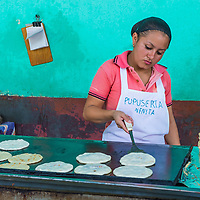 SUCHITOTO , EL SALVADOR  - MAY 07 : Salvadoran woman prepares Popusas in Suchitoto El Salvador on May 07 2016. Popusa is a traditional Salvadoran dish made of corn tortilla