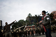 EGYPT, Cairo : Egyptian anti-government protesters calling for the ouster of President Hosni Mubarak at Tahrir Square in Cairo on February 5, 2011. Protesters scream to prevent the troops pulling out and leaving the square vulnerable to the feared interior ministry riot police or militants loyal to Mubarak's ruling National Democratic Party.© ALESSIO ROMENZI