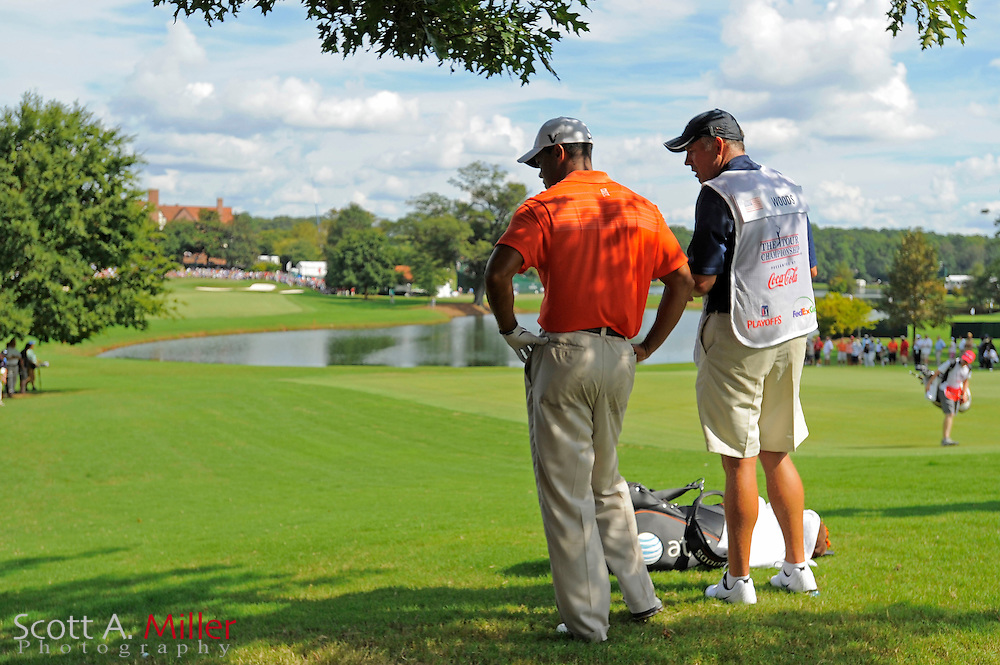 Tiger Woods (USA) and his caddie Steve Williams look at Woods' ball under a tree on the ninth hole during the second round of the PGA Tour Championship at East Lake Golf Club on Sept. 25, 2009 in Decatur, Ga.     ..©2009 Scott A. Miller