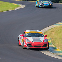 Alton, VA - Aug 26, 2016:  The RS1 Zero Lag Communicatins Intervision Porsche Cayman races through the turns at the Oak Tree Grand Prix at Virginia International Raceway in Alton, VA.