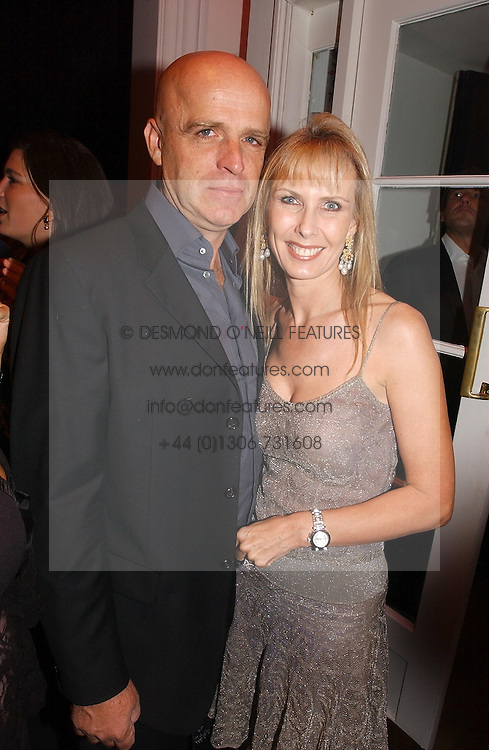 JONATHAN INGRAM and SUSAN SANGSTER at a party hosted by jeweller Theo Fennell and Dominique Heriard Dubreuil of Remy Martin fine Champagne Cognac entitles 'Hot Ice' held at 35 Belgrave Square, London, W1 on 26th October 2004.<br />