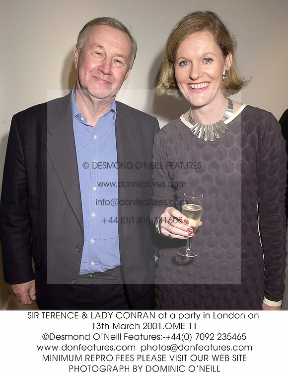 SIR TERENCE & LADY CONRAN at a party in London on 13th March 2001.OME 11