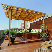 New York Rooftop terrace designed with two decks, pergola, cabana and custom furniture.