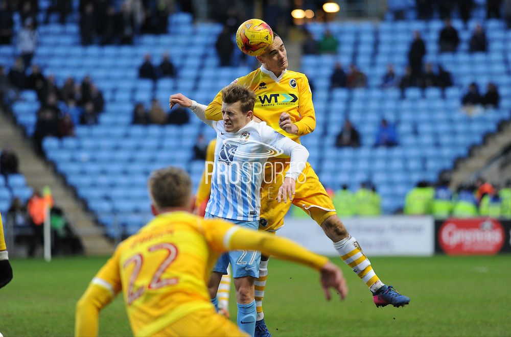 Shaun Williams of Millwall (6) gets above George Thomas of Coventry City (27)  during the EFL Sky Bet League 1 match between Coventry City and Millwall at the Ricoh Arena, Coventry, England on 4 February 2017. Photo by Andy Handley.