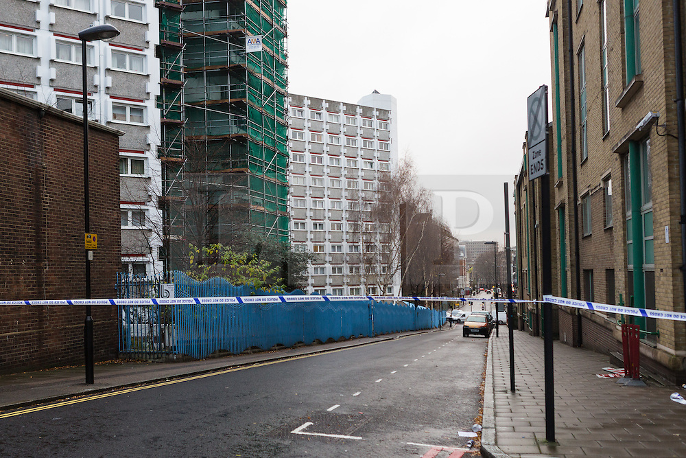 © Licensed to London News Pictures. 03/01/2015. London, UK. Police cordon in place at the top of Penton Rise in Islington showing Stelfox House flats. Police have launched a murder investigation after two men were found dead following a suspicious house fire in Penton Rise in Islington, north London last night. Photo credit : Vickie Flores/LNP