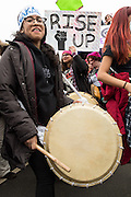 Drummers motivate the crowd during the Women's March on Washington in protest to President Donald Trump January 21, 2017 in Washington, DC. More than 500,000 people crammed the National Mall in a peaceful and festival rally in a rebuke of the new president.
