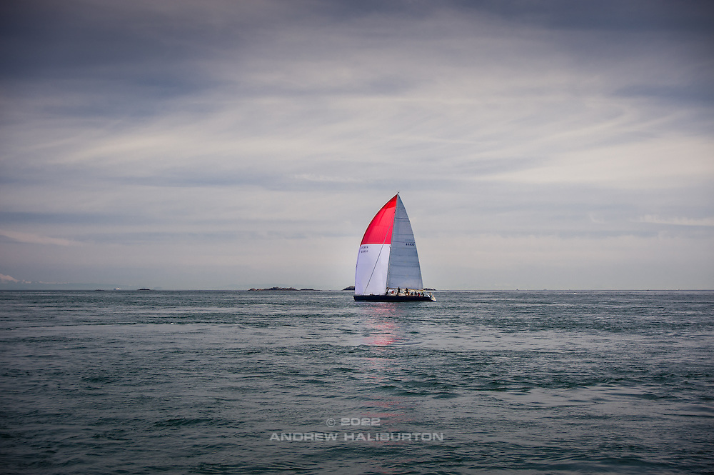 Tom Wylie-designed 70-footer Rage bucks a 5-knot ebb current passing through Race Passage en route from Astoria, Oregon to win line honors in Victoria, British Columbia in the 2015 Oregon Offshore International Yacht Race.  Rage was built by Schooner Creek Boat Works in Portland, Oregon.