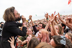 © Licensed to London News Pictures. 27/06/2015. Pilton, UK.  Father John MIsty performing at Glastonbury Festival 2015 on Saturday Day 4 of the festival on the The Park Stage stage.  This years headline acts include Kanye West, The Who and Florence and the Machine, the latter being upgraded in the bill to replace original headline act Foo Fighters. Photo credit: Richard Isaac/LNP
