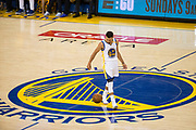 Golden State Warriors guard Stephen Curry (30) dribbles the ball at mid-court against the Cleveland Cavaliers during Game 1 of the NBA Finals at Oracle Arena in Oakland, Calif., on June 1, 2017. (Stan Olszewski/Special to S.F. Examiner)