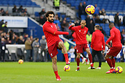 Liverpool striker Mohamed Salah (11) in warm up during the Premier League match between Brighton and Hove Albion and Liverpool at the American Express Community Stadium, Brighton and Hove, England on 12 January 2019.