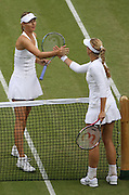 30/06/2011 - Wimbledon (Day 10) - Ladies' Singles Semi-Finals - Maria Sharapova vs. Sabine Lisicki - The two players shake hands after their match - Photo: Simon Stacpoole / Offside.