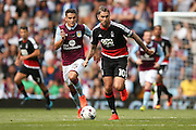 Nottingham Forest midfielder Henri Lansbury (10) gets away from Aston Villa   midfielder Ashley Westwood (15)  during the EFL Sky Bet Championship match between Aston Villa and Nottingham Forest at Villa Park, Birmingham, England on 11 September 2016. Photo by Simon Davies.