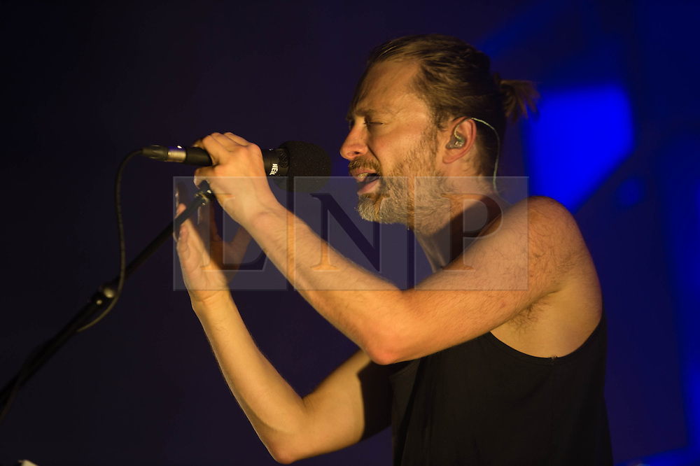 © Licensed to London News Pictures. 24/07/2013. London, UK.   Thom Yorke of Atoms for Peace performing live at The Roundhouse. Atoms For Peace is an experimental rock & electronic supergroup formed in late 2009 in Los Angeles, California. The group consists of Radiohead lead singer Thom Yorke (vocals, guitar, and piano), Red Hot Chili Peppers bassist Flea, longtime Radiohead producer Nigel Godrich (keyboards, synths, guitars), Joey Waronker of Beck & R.E.M. (drums) and Brazilian instrumentalist Mauro Refosco (percussion) of Forro in the Dark. Their debut album, Amok, was released on February 25, 2013.   Photo credit : Richard Isaac/LNP